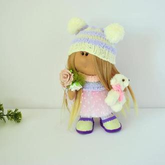 Кукла Тильда в шапке с помпонами и белым мишкой