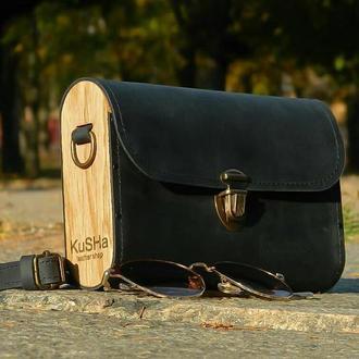 Натуральная кожаная сумка черного цвета