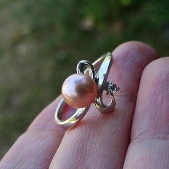 Серебряное кольцо (17,5) с жемчужиной и цирконом