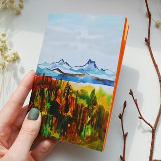 """Блокнот А6 с оранжевыми страницами. Авторская иллюстрация """"Альпы"""""""