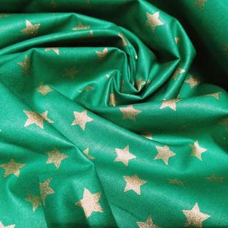 Ткань хлопок с золотыми звездочками зеленая