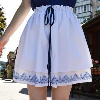 Біла спідниця з синьою вишивкою SW02.2