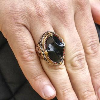 Вытянутое мужское кольцо на всю фалангу с ювелирным темно красным камнем в серебре ручной работы