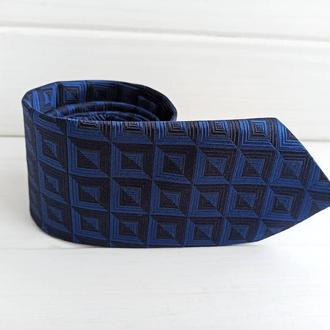 Синий шелковый галстук в клетку