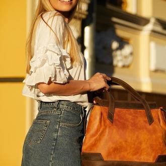 Вместительная женская сумка из натуральной кожи.