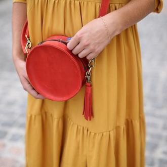 Кругла червона сумка з натуральної шкіри