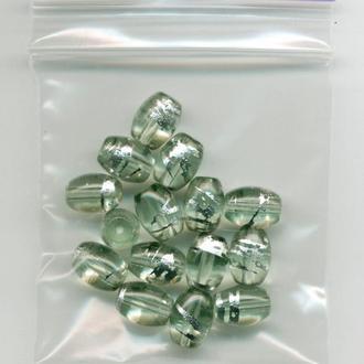 Бусины стекло 15 шт. овальные светло-зеленые, серебристый рисунок