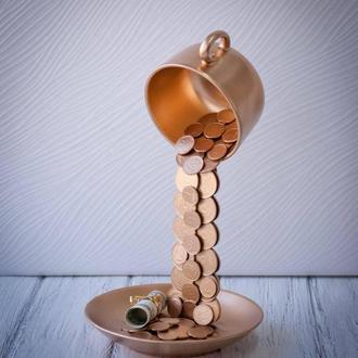 Левітуюча чашка з монет золота