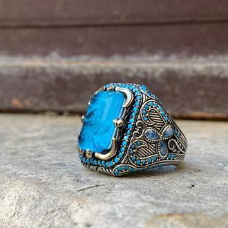 Уникальное кольцо серебряное мужское с ярким голубым камнем Параиба