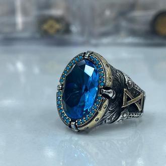 Серебряное кольцо мужское с красивым орнаментом голубым синим граненым камнем