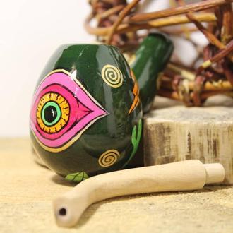 Глас и символы на деревянной курительной трубке