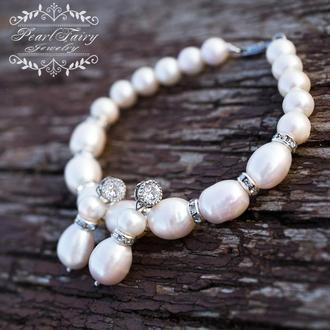 Комплект з великих натуральних білих перлів браслет і сережки