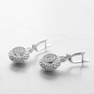Серебряные серьги с круглыми прозрачными кристаллами Swarovski