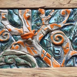Декоративная керамическая плитка с тематическим рельефом.