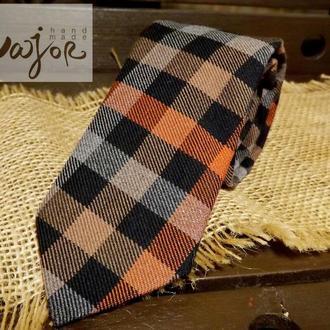 Клетчатый галстук оранжево-черный