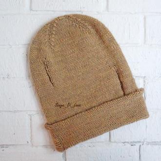 Очень крутая шапка с неземным составом. имитация дырок