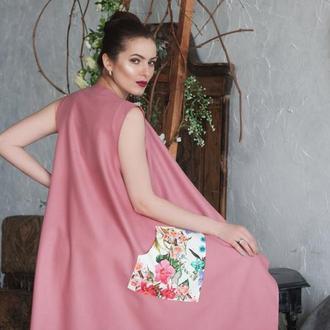 Розовая жилетка с карманами
