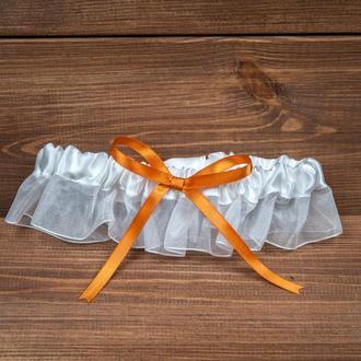 Свадебная подвязка с оранжевой лентой