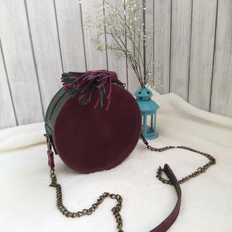 Круглая женская сумочка.