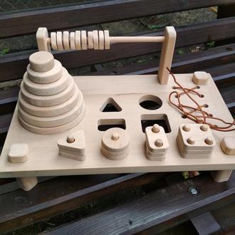 Детская игрушка (развивающий столик) из натурального дерева