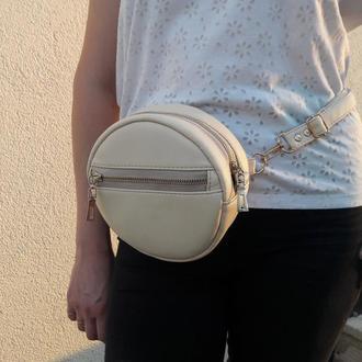 Жеснкая круглая сумочка как на пояс бананка, так и через плечо