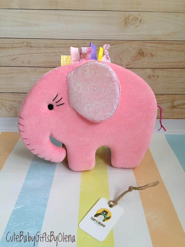 Плюшевый розовый слон