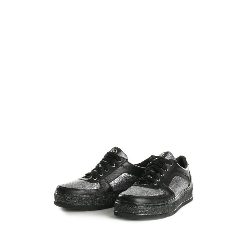 Кожаные кеды черного цвета с серебристыми вставками