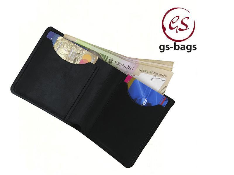 Кожаный мужской бумажник черного цвета