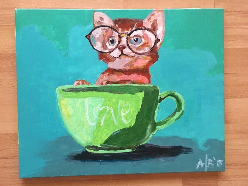 Котёнок в чашке