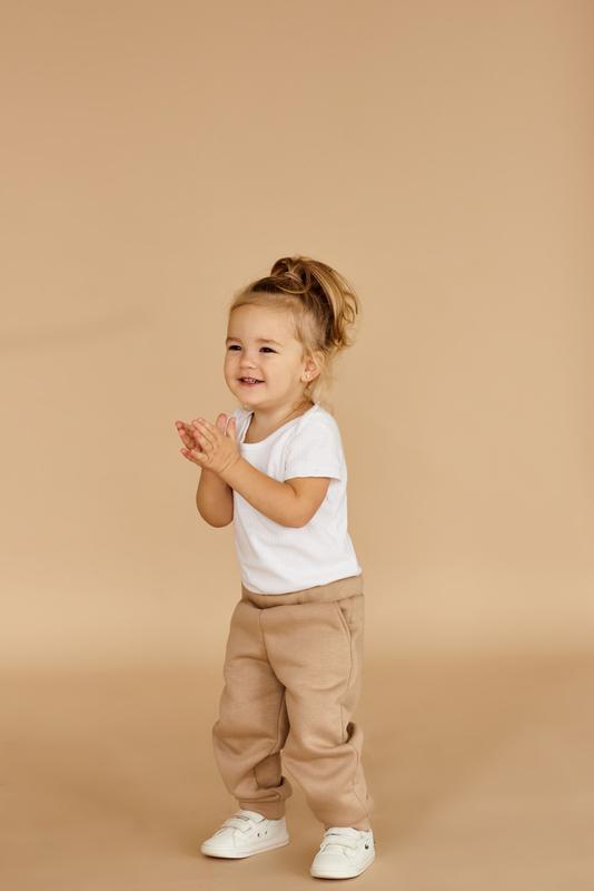 Штаны джоггеры для девочек утепленные спортивные брюки с манжетами
