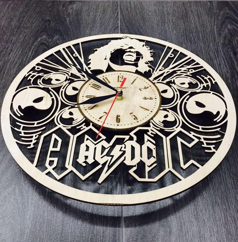Концептуальные настенные часы «AC/DC»