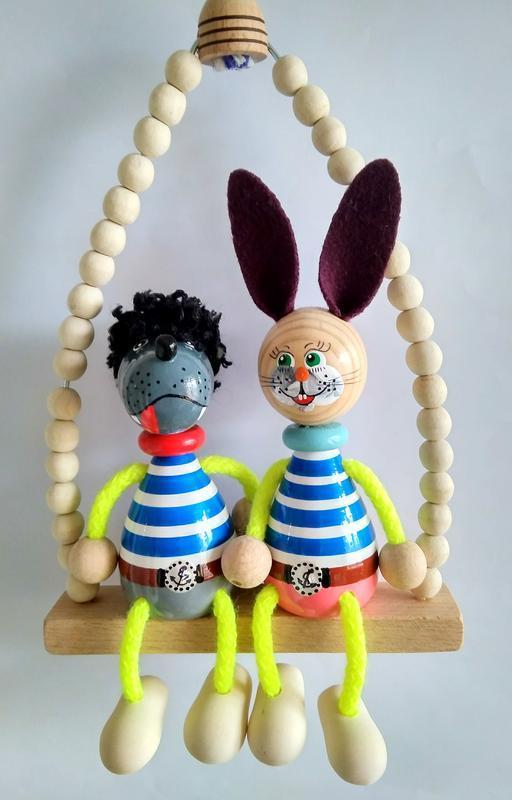 Сувенірні ляльки на гойдалках